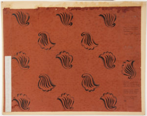 red background with black printed shell repeat pattern