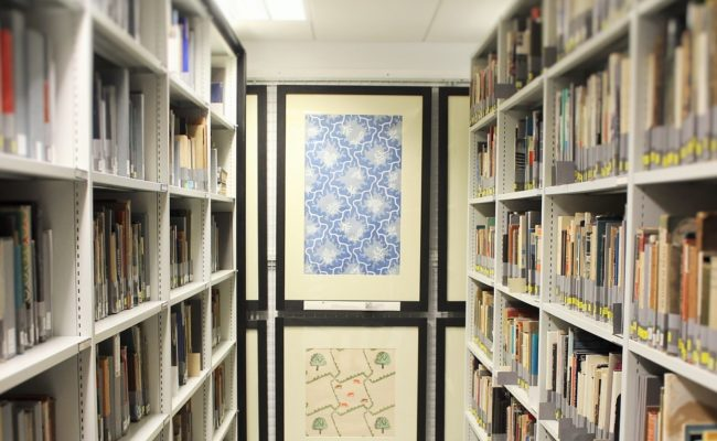 Shelving, books and framed wallpapers in the MoDA collection store