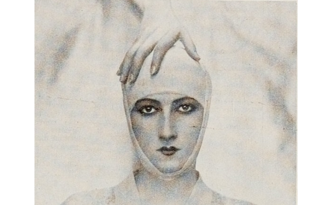 Demayer advertisment photograph for Elizabeth Arden of woman's head wrapped in white showing only her face and a hand resting on her head